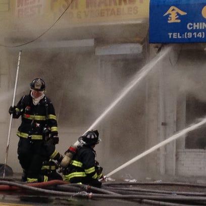 Firefighters battle the blaze Sunday morning at Golden