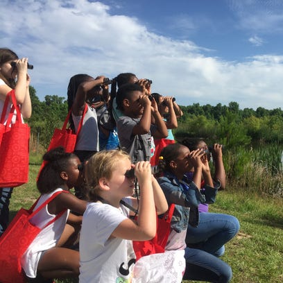 Astoria Park Elementary students watch birds at the