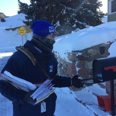 Mail carrier Logan Pike completes his route in Havre