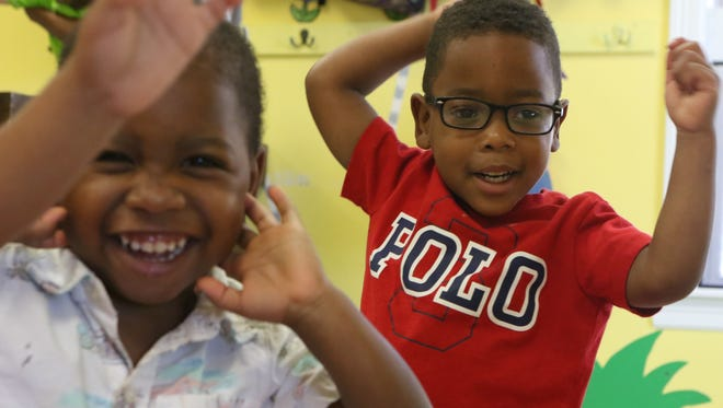 Jayden Johnson, 2, and Kenden Ceasar, 3 , dance along to a music video at Helping Hands Pediatric Health Center in Monroe on Friday, May 13. The center, which provides care for children with disabilities, opened four years ago and has since opened facilities in Shreveport, Jackson and Vicksburg.