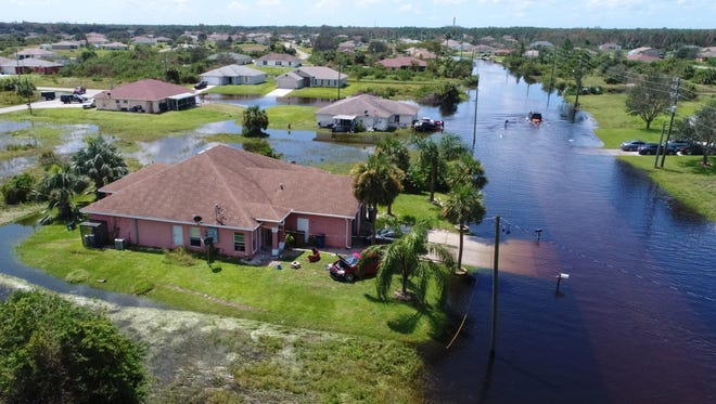 Homes are turned into islands Tuesday, Sept. 12, 2017, near Lehigh High School two days after hurricane Irma passed through the Lehigh Acres area outside Fort Myers, Fla.