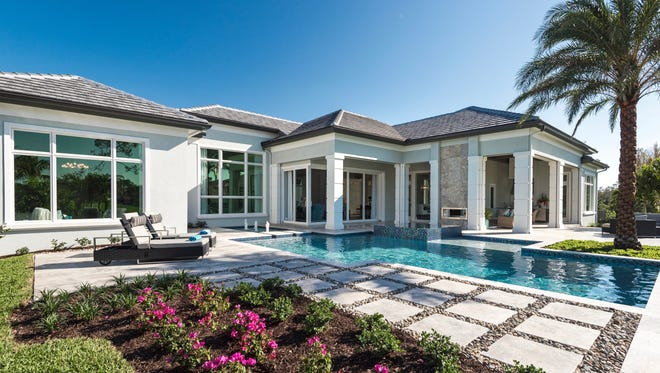 McGarvey Custom Homes' Southampton model is one of two furnished models available immediately in Quail West.