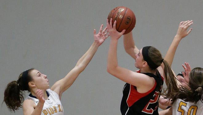 Pewaukee 's MacKenzie Schill  (right, shown in a game last season) scored 25 points against Germantown.