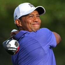 Tiger Woods tees off the first hole during the first round of the PGA Championship.
