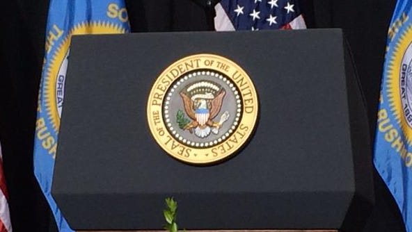 The presidential seal on the podium at Lake Area Tech.