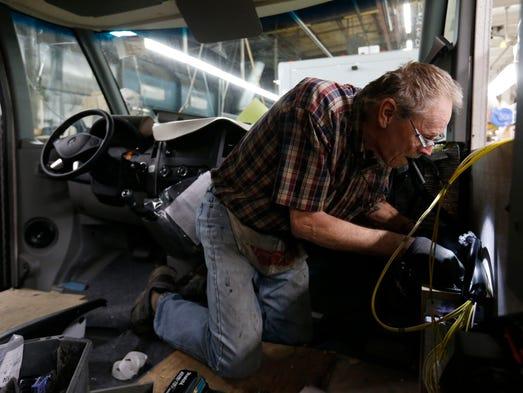Larry Schuchhardt of Hayfield, Iowa, works on the wiring