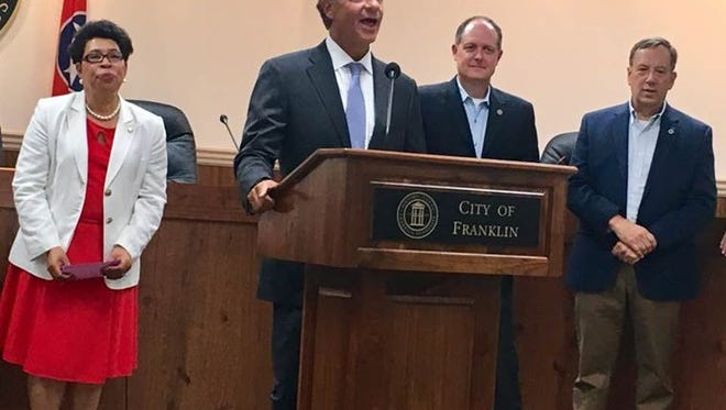 Gov. Bill Haslam announces a $1 alternative transportation grant for the City of Franklin on Friday, July 21, 2017, as Alderman-at-large Pearl Bransford, State Senator Jack Johnson and Representative Sam Whitson look on.