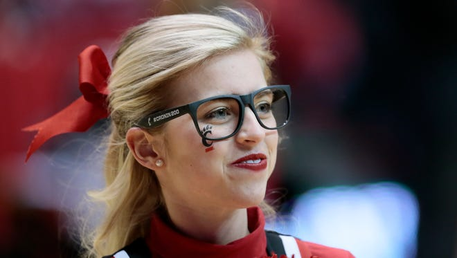 A Cincinnati Bearcats cheerleader wears replica eyeglasses to recognize head coach Mick Cronin's 200th win in the first half during the NCAA basketball game between the South Florida Bulls and the Cincinnati Bearcats, Thursday, Feb. 4, 2016, Fifth Third Arena in Cincinnati. Cincinnati led 36-29 at the half.
