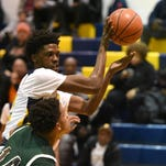 Pocomoke's Kwamaine Atkins grabs a rebound against Parkside on Tuesday, Feb 9 at Pocomoke High.
