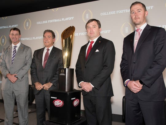 The two men standing closest to the College Football
