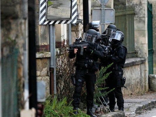 AP APTOPIX FRANCE NEWSPAPER ATTACK I FRA