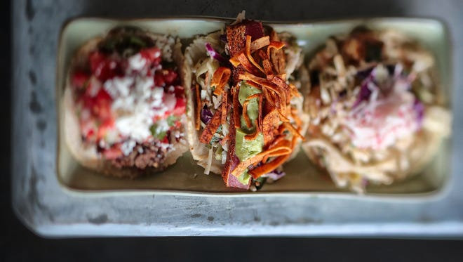 This trio of tacos includes the Carne de Vaca taco, which is beef tenderloin, pico de gallo, salsa roja and cotija cheese; Atun, which is spice-seared Saku tuna, cilantro slaw, avocado crema and spicy tortilla strips; and Camarones, grilled or fried Gulf shrimp, cilantro slaw, radish and comeback sauce.