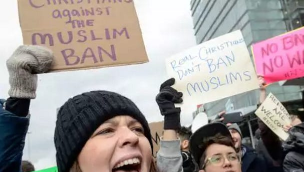 Protesters rally during a protest against the Muslim immigration ban at John F. Kennedy International Airport on Jan. 28, 2017