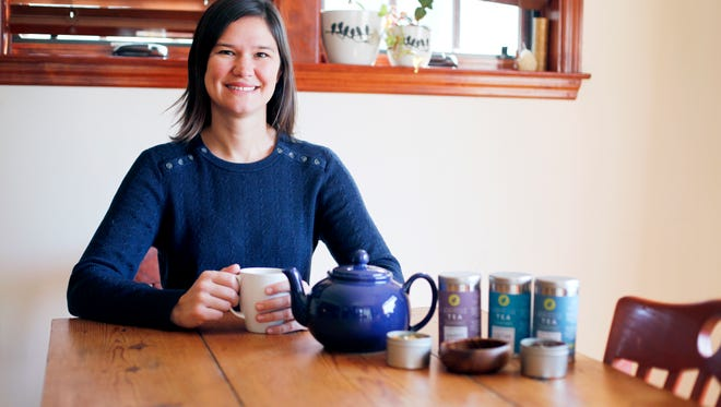 Asheville Tea Company's Jessie Dean pours a cup in her home February 10, 2017. She is working to make the tea experience a hyper-local affair, and she's using herbs and plants like the yaupon, which she said is somewhat like yerba mate.