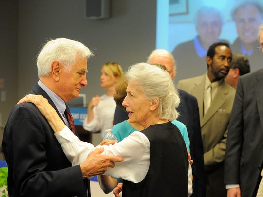 Bill Kovach, a reporter at The Tennessean during the 1960s, talks with John Seigenthaler's widow, Dolores, during the former Tennessean editor and publisher's visitation July 13, 2014, at the First Amendment Center in Nashville.