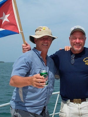 """Bill Lee, left, and Randy Wayne White shown here off the coast of Cuba. The two met in 1989 and have since been friends. Lee inspired the character """"Tomlinson"""" of the 24 """"Doc Ford"""" novels written by White."""