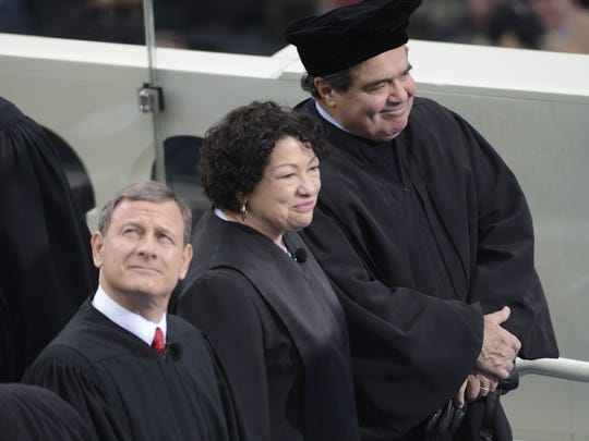 Chief Justice John Roberts and Associate Justices Sonia Sotomayor and Antonin Scalia at President Obama's second inauguration in January 2013.