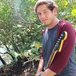 Musician Jake Salter sings, writes and plays guitar and piano.