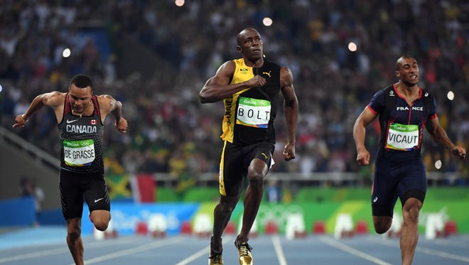 Aug 13, 2016; Rio de Janeiro, Brazil;  Usain Bolt (JAM) celebrates after winning the men's 100m final in the Rio 2016 Summer Olympic Games at Estadio Olimpico Joao Havelange.