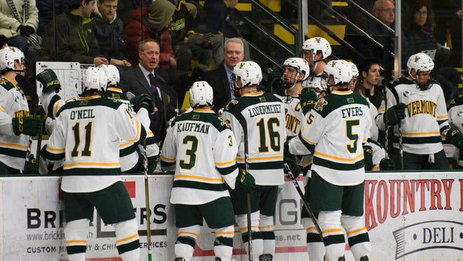 \Vermont head coach Kevin Sneddon talks to the team during a time out in the men's hockey game between the Providence Friars and the Vermont Catamounts at Gutterson Fieldhouse on Friday night February 2, 2018 in Burlington.