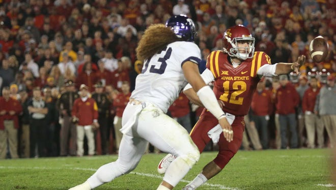 Iowa State quarterback Sam Richardson pitches the ball before being tackled during the TCU at Iowa State football game on Saturday, Oct. 17, 2015 at Jack Trice Stadium in Ames, Iowa. The ball was later fumbled on the play with Iowa State marching for a tiebreaking score in the second quarter.