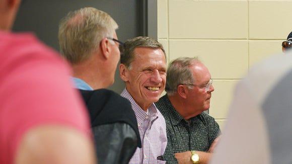Paul Halstenson talks to old teammates inside the field