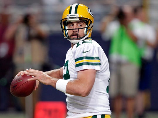 Green Bay Packers quarterback Aaron Rodgers throws during the first quarter of an NFL preseason football game against the St. Louis Rams Saturday, Aug. 16, 2014, in St. Louis. (AP Photo/Tom Gannam)