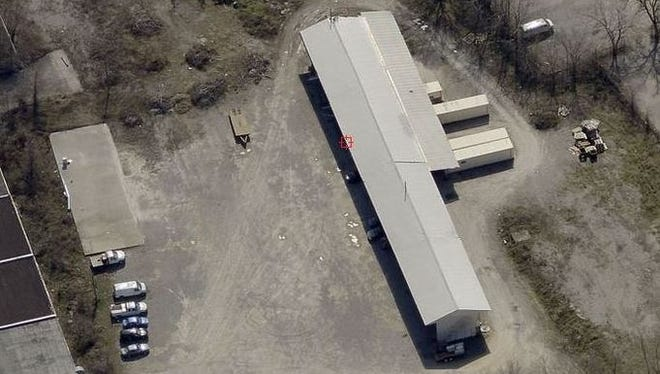 An aerial view of the former lumber yard at 311 Carter St. where Woodbine Park is planned.