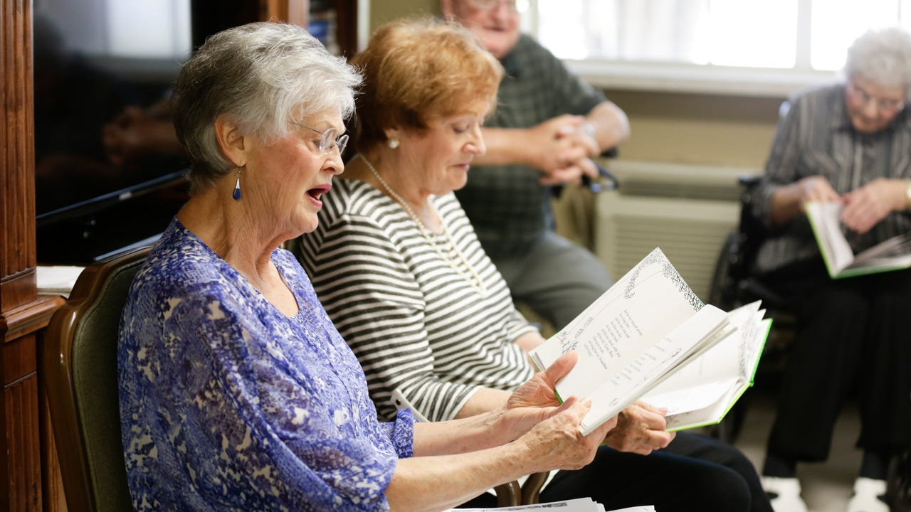 Betty Roy and her sister Mavis Fruge read L'Arbre Genereux (The Giving Tree) to nursing home residents in Arnaudville.