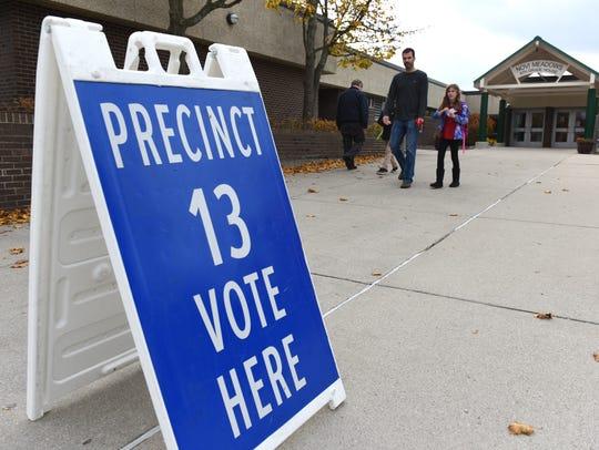 Voters casting their ballots at Novi's Precinct 13