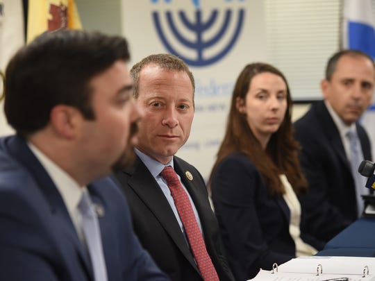 Jared Maples (L), Director of NJOHSP, speaks as Congressman Josh Gottheimer, and FBI Special Agents Carly Rasiewicz and Anthony Zampogha listen during a Synagogue Security Summit focused on keeping houses of worship safe, photographed at the Jewish Federation of North Jersey in Paramus on 06/11/18.