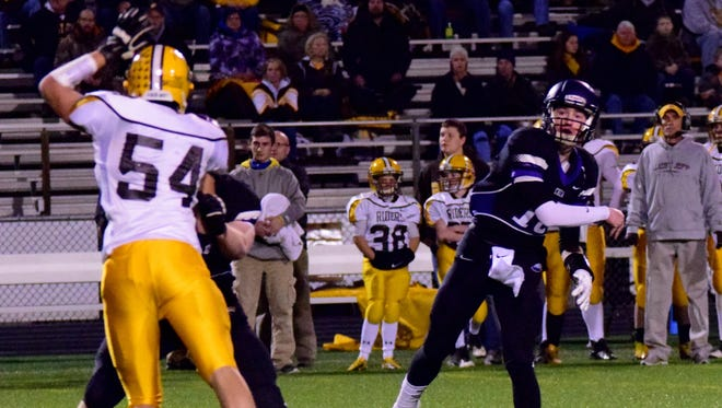 CHCA quarterback Johnny Noyen completes a pass over the head of West Jefferson's Connor Dickerson.