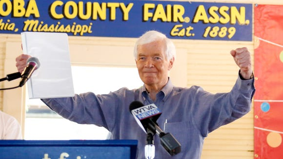 U.S. Sen. Thad Cochran, R-Miss., presents a winner's gesture to the audience at the Neshoba County Fair in Philadelphia, Miss., Thursday, July 31, 2014. Cochran faces Democrat Travis Childers for his seat in the fall. The fair is a traditional gathering place for politicians, area residents, business leaders, voters and families. (AP Photo/Rogelio V. Solis)