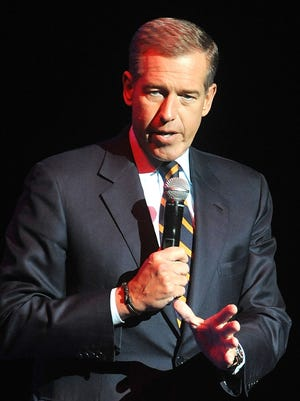 Brian Williams, shown in November 2014, is helping his alma mater.