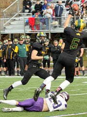 Burr and Burton's Carter Vickers intercepts a fourth-quarter pass in front of teammate Sean Apps in the Bulldogs' 28-7 win over Bellows Falls in the Division II state high school football championship game on Saturday, Nov. 7, 2015.