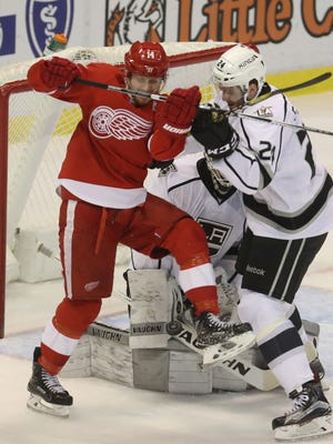 Detroit Red Wings forward Gustav Nyquist, left, is checked by the Los Angeles Kings' Derek Forbort on Dec. 15, 2016.
