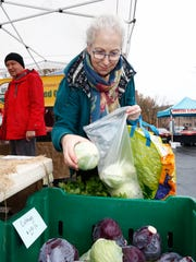 Julia Lichten of South Nyack buys cabbage from the