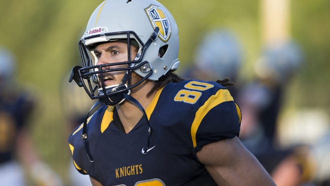 Krishawn Hogan of Marian University is headed west to play for Bruce Arians' Cardinals.