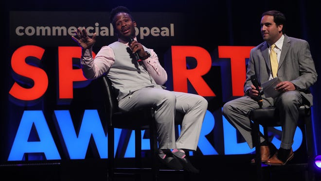 NFL running back DeAngelo Williams and The Commercial Appeal's Mark Giannotto during The Commercial Appeal's Sports Awards show in June at the Orpheum Theatre.
