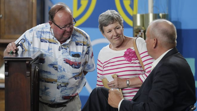 """Antiques Roadshow"" furniture expert John Sollo of David Rago Auctions, right, evaluates an antique furniture piece for owners Tom and Jill P. of Green Bay last June when the PBS show visited the Resch Center."