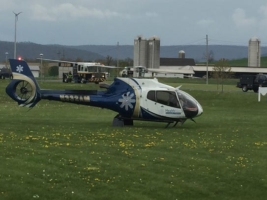 A helicopter lands in the James Buchanan Senior High