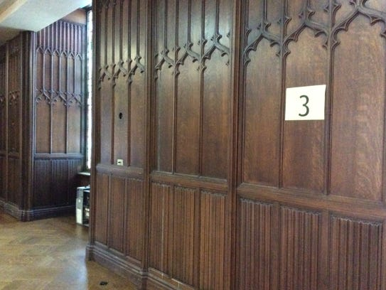 Wood paneling and gothic molding lends a medieval air