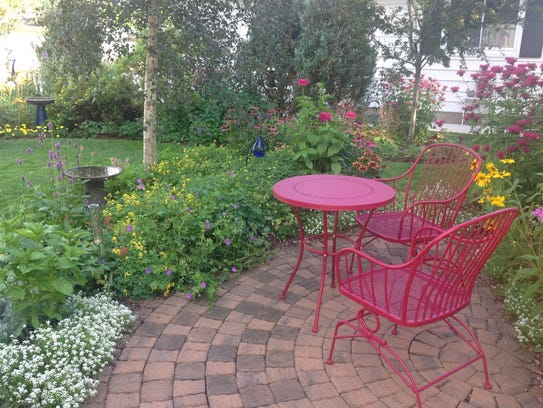 A colorful mix of annuals and perennials will greet