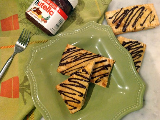 Baked Nutella Breakfast Pastries enclose a filling