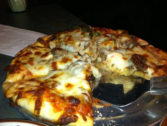 The Other Place restaurant and sports bar is known for its pizza. An OP recently opened in Ankeny.