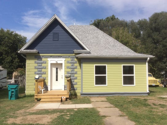 """This is the """"after"""" photo of a house in Woodland Heights recently spruced up — with fresh paint, new windows, roof and front porch — by Habitat for Humanity of Springfield."""