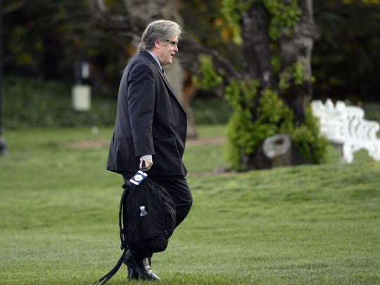 Steve Bannon walks on the South Lawn upon arrival at