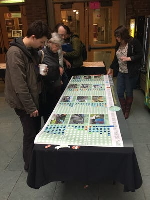 Visitors rate ideas to revamp the East Main Street corridor at an open house at School of the Arts on Tuesday.