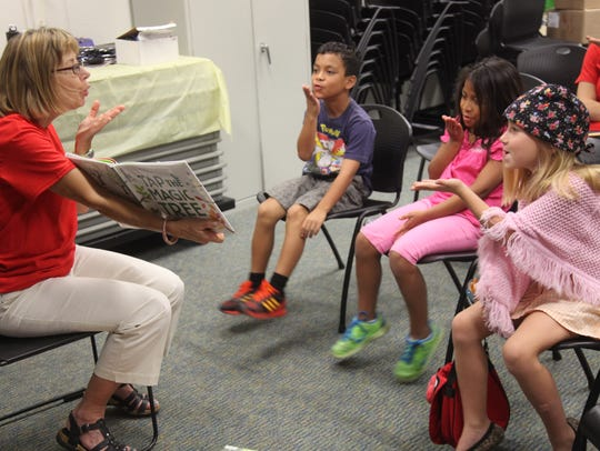 Cynthia Krakowski, of Bonita Springs, reads to Cefe