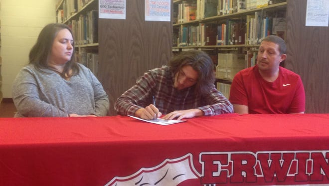 Erwin senior Damien Ferguson has signed to play college football for Mars Hill.